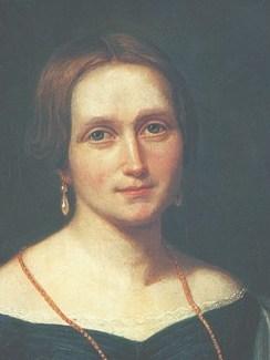 """En af Norges store forfattere Camilla Collett fik i alt tre års formel skolegang. Ét år gik hun på pigeskole i Christiania og fra 1827-1829 var hun elev på Brødremenighedens pigeskole. Hun har skrevet om sin tid i Christiansfeld i den selvbiografiske bog """"I de lange nætter"""" fra 1862.  I det meste af det Camilla Collett skrev tematiserede hun kvinders stilling i samfundet og litteraturen. Hun kæmpede offentligt for kvinders frigørelse, for respekt og ligeværd.  Camilla Colletts navn, født Wergeland, er opført på mindepladen ved siden af indgangen til Pigeskolen."""